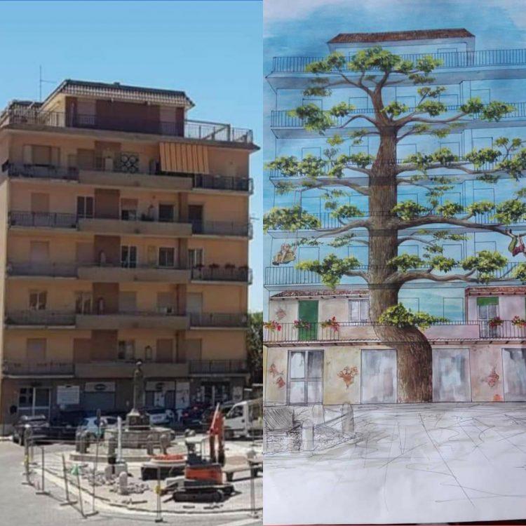Allumiere, un grande faggio dipinto sulla facciata del palazzo di piazza della Repubblica